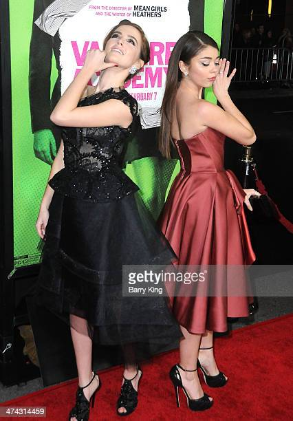 Actress Zoey Deutch and actress Sarah Hyland attend the premiere of 'Vampire Academy' on February 4 2014 at Regal Cinemas LA Live in Los Angeles...