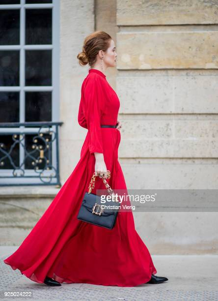Actress Zoey Deutch wearing red dress with belt black bag is seen outside Dior on February 27 2018 in Paris France
