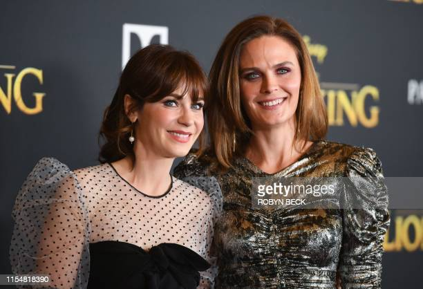 "Actress Zooey Deschanel and her sister actress Emily Deschanel arrive for the world premiere of Disney's ""The Lion King"" at the Dolby theatre on July..."