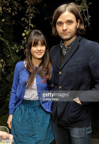 Actress Zooey Deschanel and husband musician Ben Gibbard attend an evening of fashion and compassion hosted by Zooey Deschanel and Emily Deschanel...