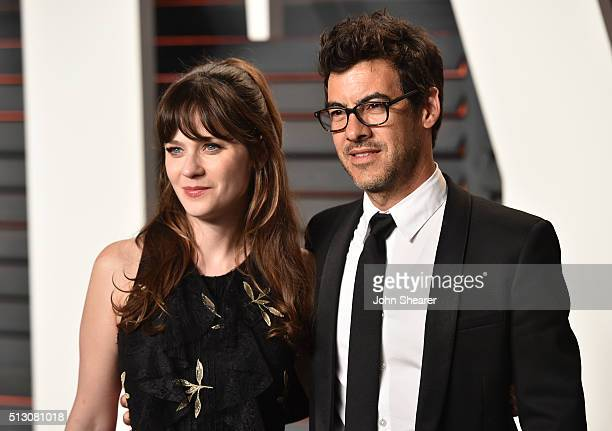 Actress Zooey Deschanel and Jacob Pechenik arrive at the 2016 Vanity Fair Oscar Party Hosted By Graydon Carter at Wallis Annenberg Center for the...