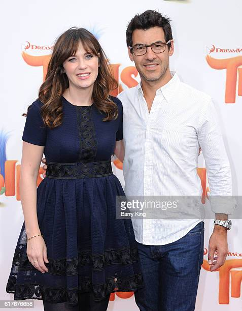 Actress Zooey Deschanel and Jacob Pechenik attend the premiere of 20th Century Fox's 'Trolls' at Regency Village Theatre on October 23 2016 in...