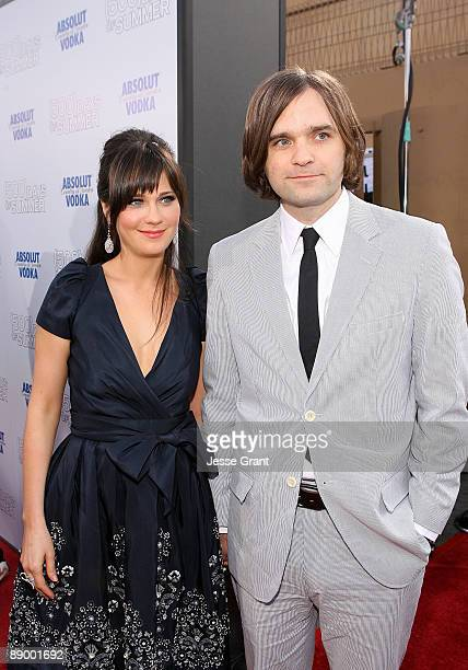 Actress Zooey Deschanel and musician Ben Gibbard arrive on the red carpet of the Los Angeles premiere of ' Days Of Summer' at the Egyptian Theatre on...