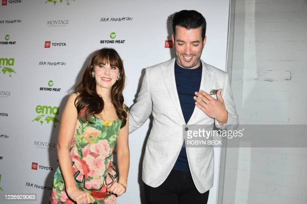 Actress Zooey Deschanel and partner Canadian TV personality Jonathan Scott arrive for the Environmental Media Association awards gala at Gearbox LA...