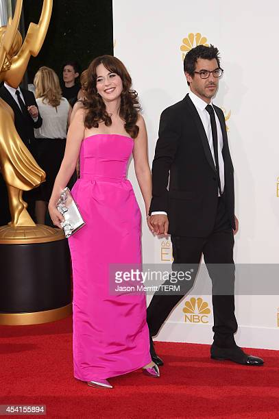 Actress Zooey Deschanel and producer Jacob Pechenik attend the 66th Annual Primetime Emmy Awards held at Nokia Theatre LA Live on August 25 2014 in...