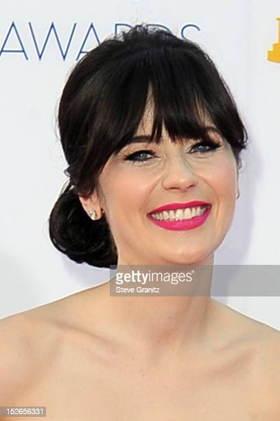 Actress Zooey Deschanel arrives at the 64th Primetime Emmy Awards at Nokia Theatre LA Live on September 23 2012 in Los Angeles California
