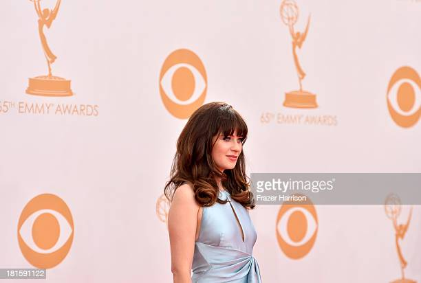 Actress Zooey Deschanel arrives at the 65th Annual Primetime Emmy Awards held at Nokia Theatre LA Live on September 22 2013 in Los Angeles California