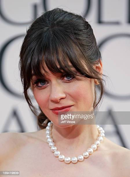 Actress Zooey Deschanel arrives at the 70th Annual Golden Globe Awards held at The Beverly Hilton Hotel on January 13 2013 in Beverly Hills California
