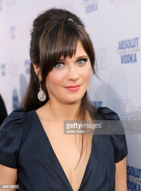 Actress Zooey Deschanel arrives on the red carpet of the Los Angeles premiere of ' Days Of Summer' at the Egyptian Theatre on June 24 2009 in...