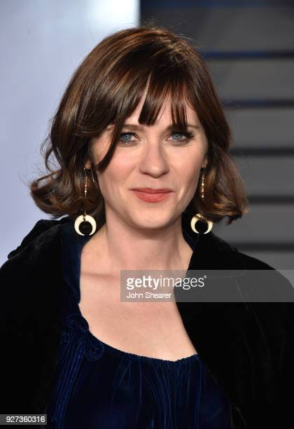 Actress Zooey Deschanel attends the 2018 Vanity Fair Oscar Party hosted by Radhika Jones at Wallis Annenberg Center for the Performing Arts on March...