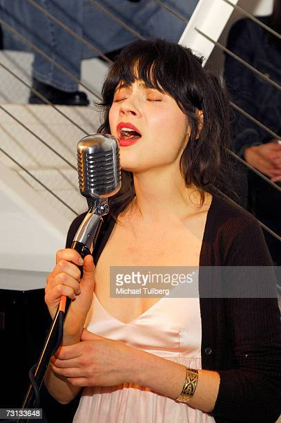 Actress Zooey Deschanel performs at the opening of the Chris Anthony art show Victims Avengers held at the Corey Helford Gallery on January 27 2007...