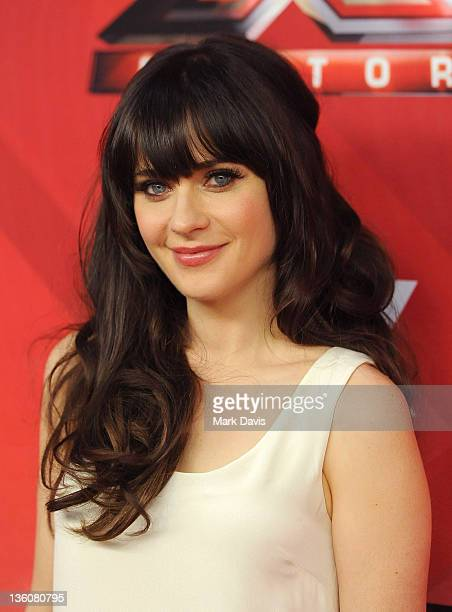 Actress Zooey Deschanel poses at Fox Television's 'The X Factor' Season Finale at CBS Television City on December 22 2011 in Los Angeles California