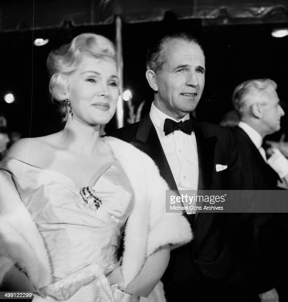 Actress Zsa Zsa Gabor and Hal Hayes at a premier of The Man in the Gray Flannel Suit in Los Angeles California