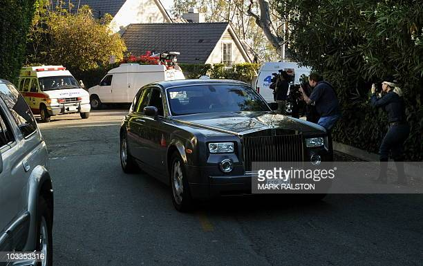 Actress Zsa Zsa Gabor arrives in an ambulance behind her husband Prince Frederic as she is returned to her home after being discharged from the UCLA...