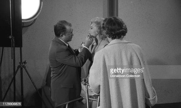 Actress Zsa Zsa Gabor gets made up on the set of the movie 'Queen of Outer Space' in 1958