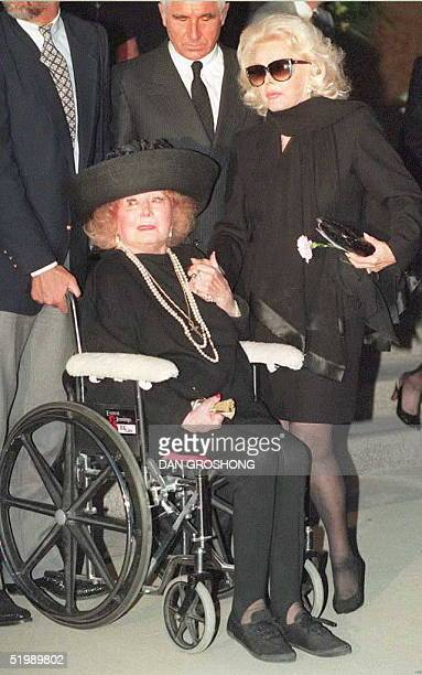 Actress Zsa Zsa Gabor holds the hand of her mother Jolie after funeral services for her sister Eva Gabor 11 July at a Beverly Hills church Eva Gabor...