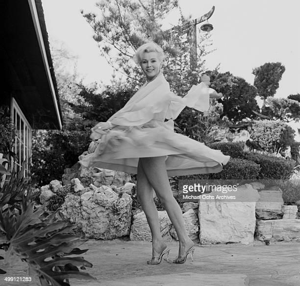 Actress Zsa Zsa Gabor poses during a photo shoot at home in Los Angeles California