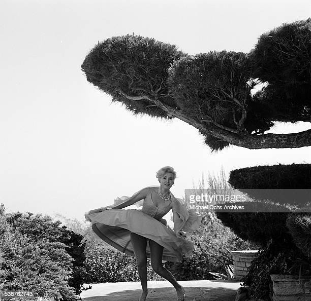 Actress Zsa Zsa Gabor poses in her garden in Los AngelesCA