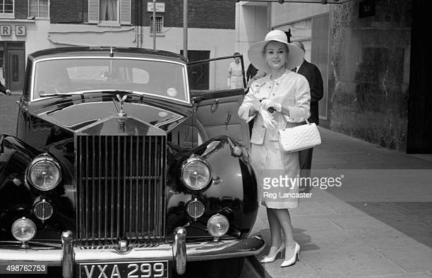 Actress Zsa Zsa Gabor wearing a wide brimmed hat and gloves leaving the Hilton Hotel London May 29th 1964