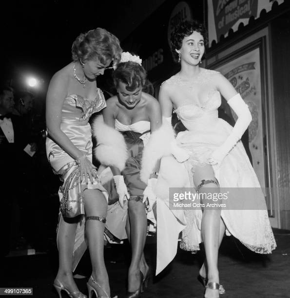 Actress Zsa Zsa Gabor with Terry Moore and Marla English as they show of Red Garters at the premier of Red Garters at Mocambo nightclub in Los...