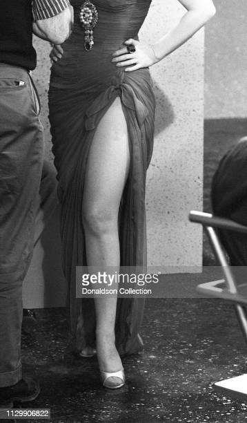 Actress Zsa Zsa Gabor's leg in a dress on the set of the movie 'Queen of Outer Space' in 1958