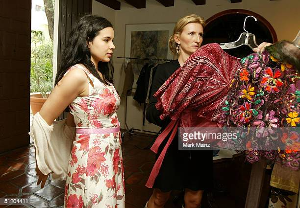 Actress Zuleikha Robinson and designer Nina Morris attend the Nina Morris Trunk Show at Patric Reeves' home August 21 2004 in Los Feliz California