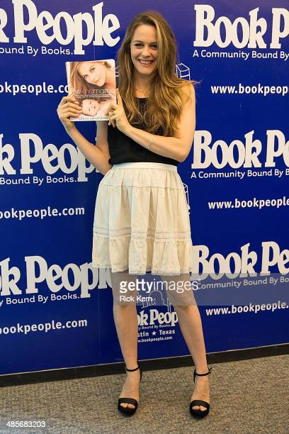 Actress/author Alicia Silverstone poses with a copy of her new book 'The Kind Mama A Simple Guide to Supercharged Fertility a Radiant Pregnancy a...