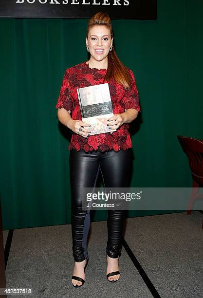 Actress/author Alyssa Milano poses for a photo during a signing for her book Hacktivist at Barnes Noble Tribeca on July 22 2014 in New York City