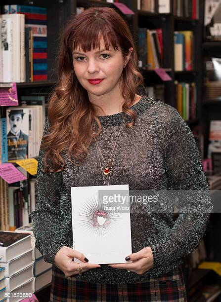 Actress/author Amber Tamblyn poses at her book signing for Dark Sparkler at Book Soup on December 15 2015 in West Hollywood California