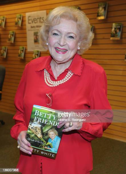 """Actress/Author Betty White signs copies of her new book """"Betty & Friends: My Life at the Zoo"""" on December 19, 2011 in Santa Monica, California."""