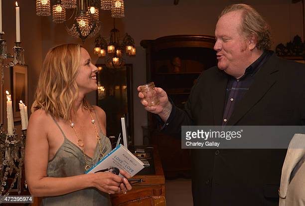 Actressauthor Maria Bello and manager John Carrabino attend the party for her book WhateverLove is Love at Obsolete on May 6 2015 in Culver City...