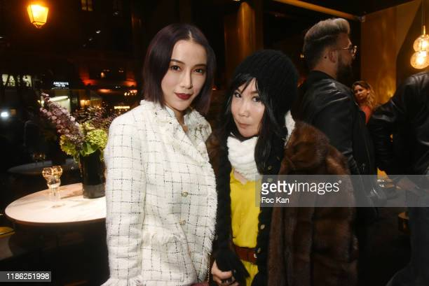 Actress/blogger Asabella Xia and actress Yubai Zhang attend the Red X BHV Marais Ephemere Boutique Launch Party on November 07 2019 in Paris France