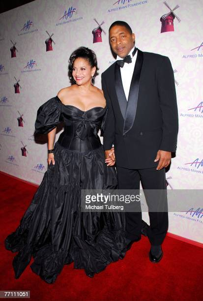 Actress/choreographer Debbie Allen arrives with husband Norm Nixon at the Fourth Annual Alfred Mann Foundation Gala held at the Millenium Biltmore...