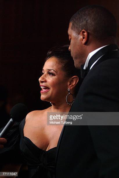 Actress/choreographer Debbie Allen does an interview as husband Norm Nixon looks on at the Fourth Annual Alfred Mann Foundation Gala held at the...
