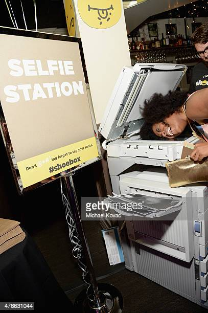 Actresscomedian Akilah Hughes takes a selfie at the selfie station during Shoebox's 29th Birthday Celebration hosted by Rob Riggle at The Improv on...