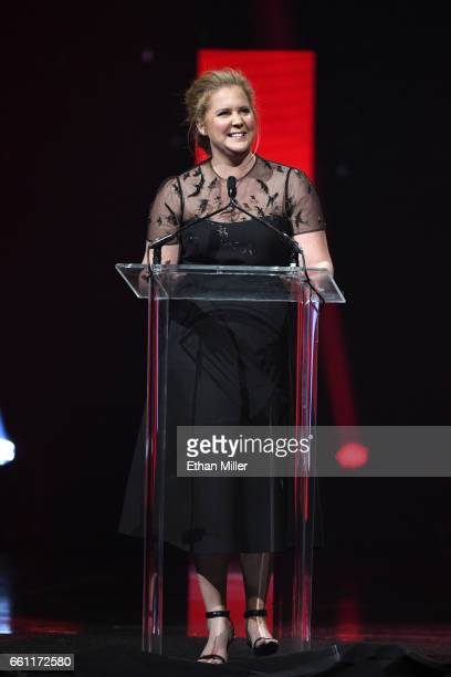 Actress/comedian Amy Schumer introduces Cinema Icon Award winner Goldie Hawn during the CinemaCon Big Screen Achievement Awards brought to you by the...
