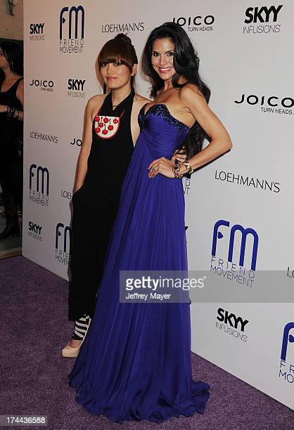 Actress/comedian Hana Mae Lee and model Joyce Giraud attend the Friend Movement AntiBullying Benefit Concert at the El Rey Theatre on July 1 2013 in...