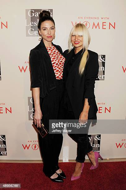 Actress/comedienne Whitney Cummings and singer/songwriter Sia arrive at the 2014 An Evening With Women Benefiting LA Gay Lesbian Center at the...