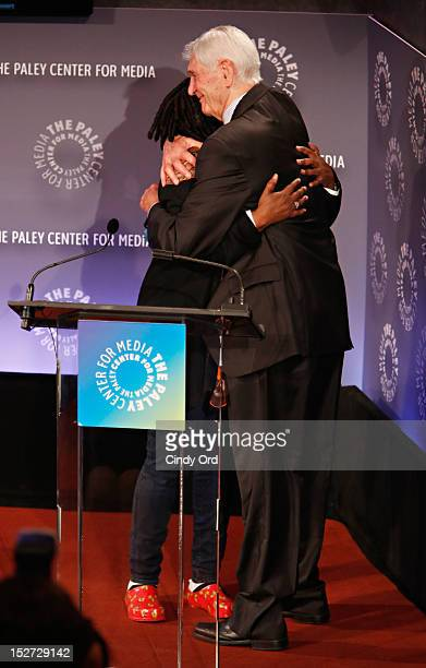 Actress/comedienne Whoopi Goldberg embraces television host Sonny Fox onstage at Sonny Fox Forty Years In Television A Conversation With Whoopi...