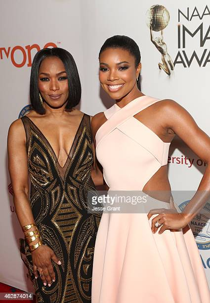 Actress/director Angela Bassett and Gabrielle Union attend the 46th NAACP Image Awards presented by TV One at Pasadena Civic Auditorium on February 6...