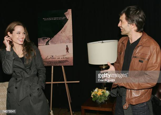 Actress/director Angelina Jolie and actor Olivier Martinez attend the Tribeca Film Institute Screening of the Angelina Jolie directed film 'A Place...