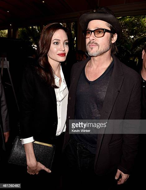 Actress/director Angelina Jolie and her husband actor Brad Pitt arrive at the 15th Annual AFI Awards at Four Seasons Hotel Los Angeles at Beverly...