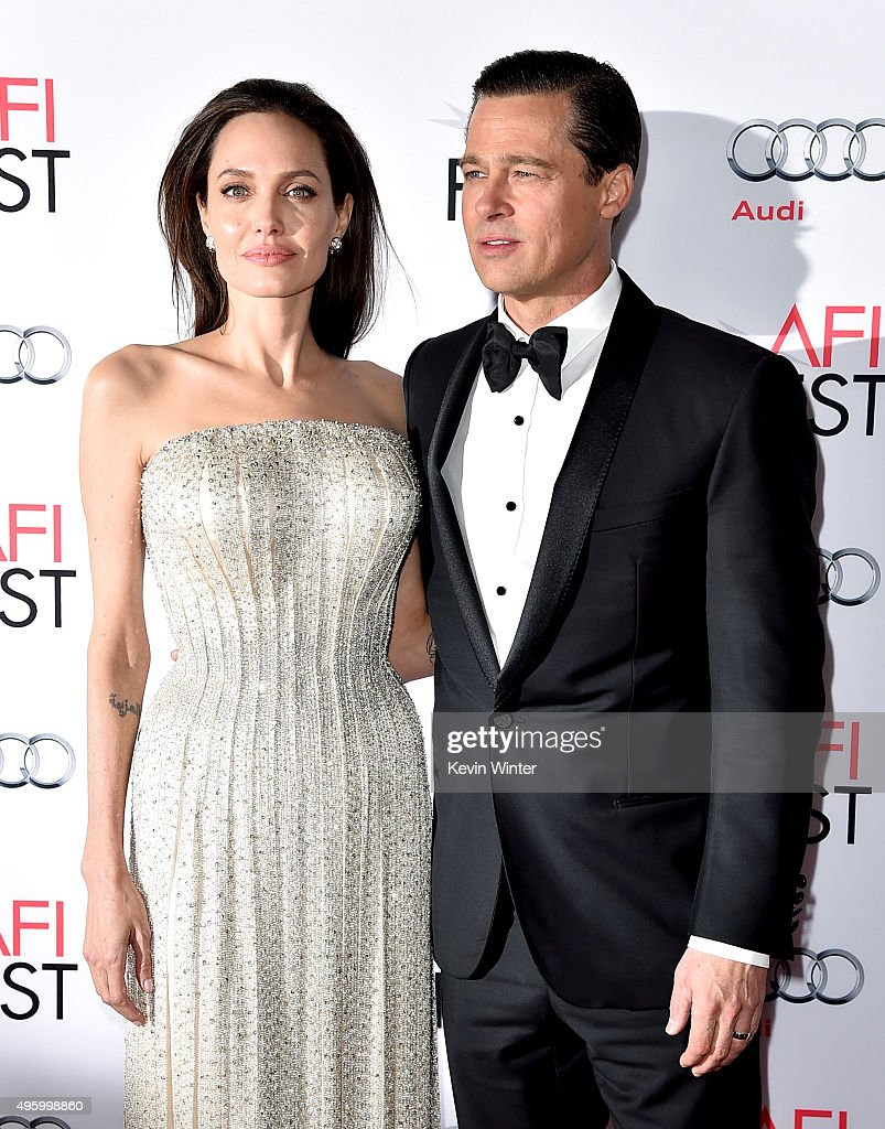 Actress/director Angelina Jolie Pitt (L) and husband actor Brad Pitt arrive at the AFI FEST 2015 presented by Audi opening night gala premiere of Universal Pictures' 'By The Sea' at the Chinese Theatre on November 5, 2015 in Los Angeles, California.