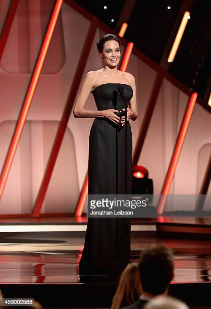 Actress/director Angelina Jolie speaks onstage during The 18th Annual Hollywood Film Awards at The Palladium on November 14 2014 in Hollywood...