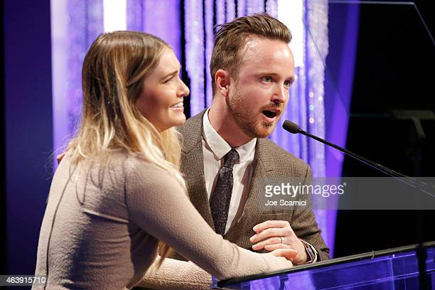 Actress/director Lauren Paul and actor Aaron Paul accept the unite2gether Award onstage at the 2nd Annual unite4humanity presented by ALCATEL...