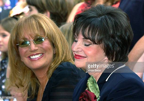 Actressdirector Penny Marshall watches as actress Cindy Williams is intorduced at the ceremony honoring each of them with a star on the Hollywood...
