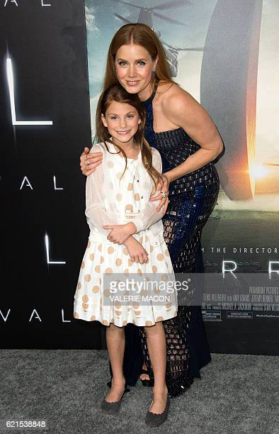 Actresses Abigail Pniowsky and Amy Adams attend the Paramount Pictures premiere of Arrival in Westwood California on November 6 2016 / AFP / VALERIE...