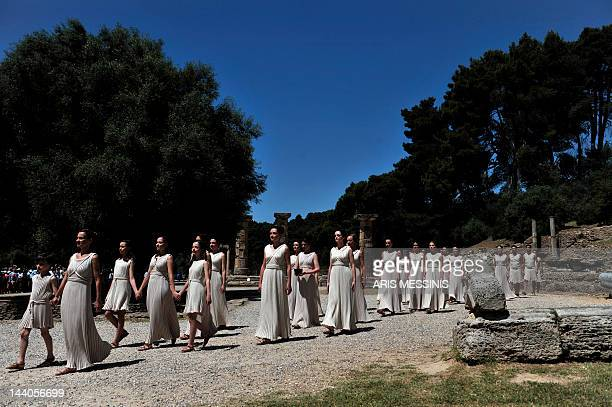 Actresses acting as priestessesperform on May 9 2012 during the lighting ceremony in ancient Olympia the sanctuary where the Olympic Games were born...