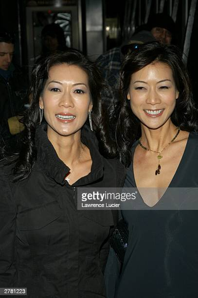 Actresses Ada and Arlene Tai arrive at the world premiere of the film Something's Gotta Give at the Ziegfeld Theater December 2 2003 in New York City