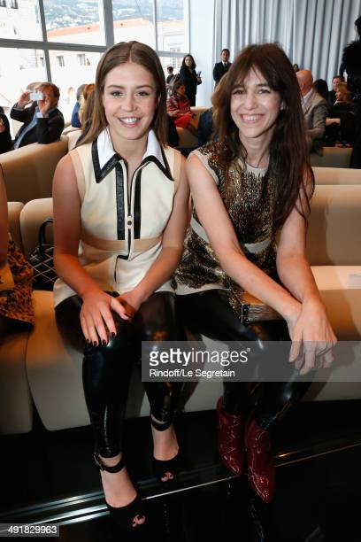 Actresses Adele Exarchopoulos and Charlotte Gainsbourg attend the Louis Vuitton Cruise Line Show 2015 at Palais Princier on May 17 2014 in MonteCarlo...